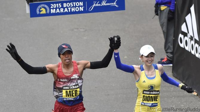 Meb Keflezighi, of the U.S. and winner of the 2014 Boston Marathon, crosses the finish line with Hilary Dionne, of the U.S., at the 119th running of the Boston Marathon in Boston